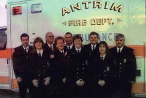 group of people in front of an ambulance