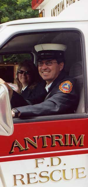 man and woman smiling in a firetruck