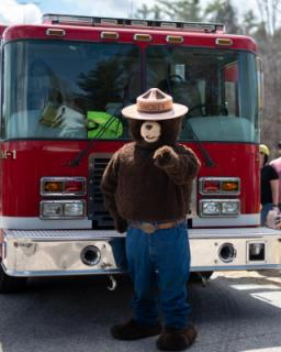 Open House with Smokey the Bear infront of the Antrim Fire truck
