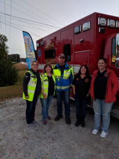 Ambulance Crew infront of Ambulance at Home & Harvest Festival