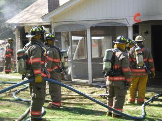 Firefighters at live burn training